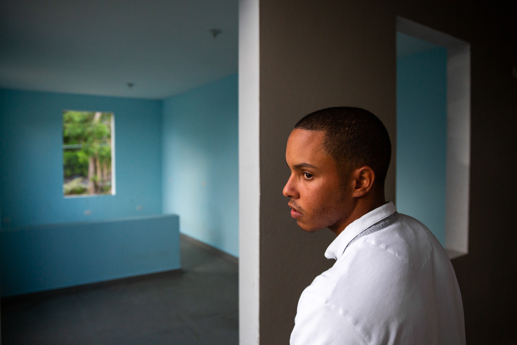 "Omar Charriez - Omar Charriez, 22, has lived at the Forjadores de Esperanza shelter in Puerto Rico for nine years. During Hurricane Maria, the shelter lost its roof and Charriez helped the other boys stay calm. After the storm was over, Charriez worried about the shelter's future. ""I was thinking 'What is going to happen now?'"" he recalled. ""If the shelter is actually going to close, what is going to happen with the kids?"" (Ellen O'Brien/News21)"