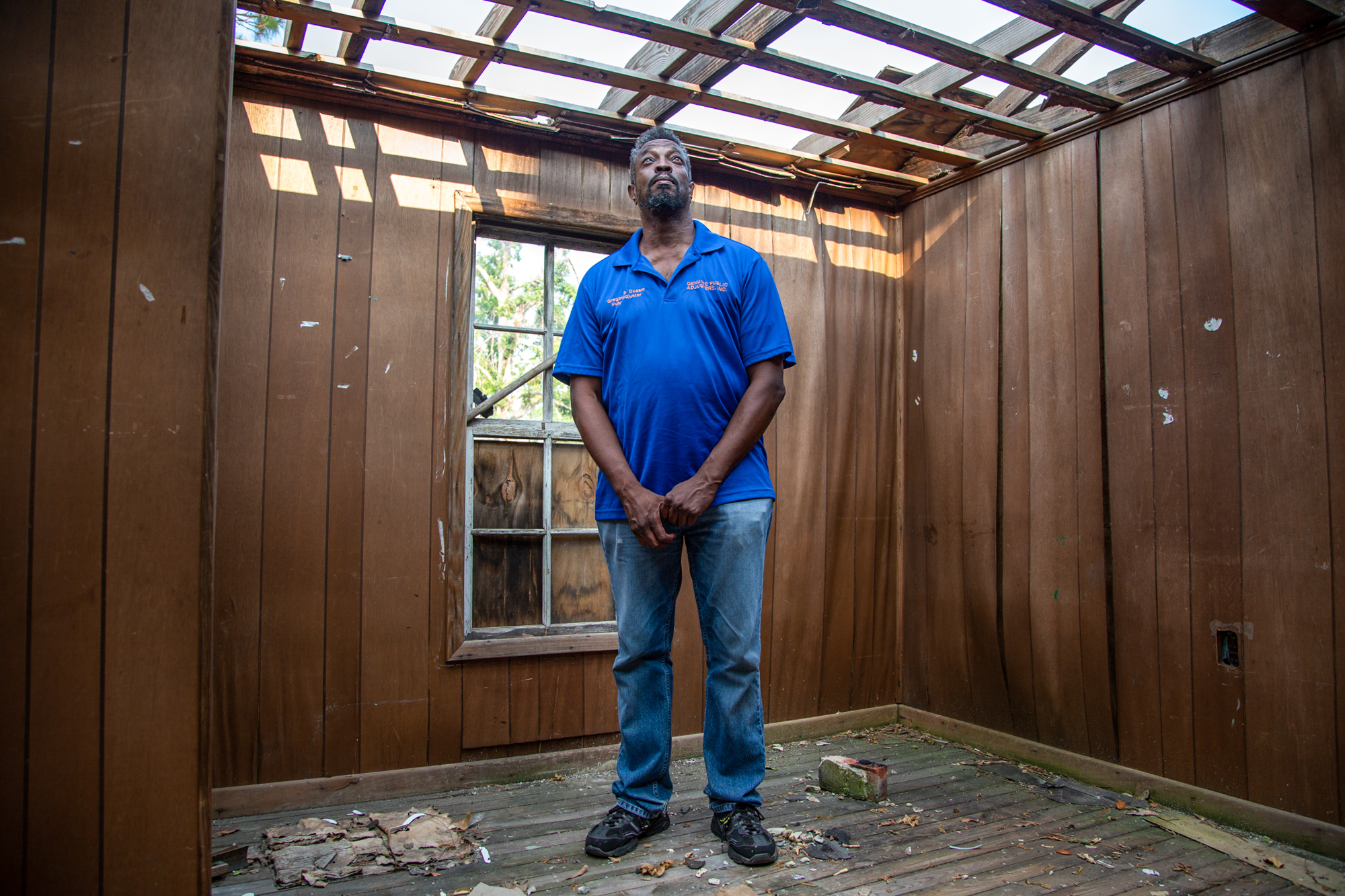 "Greg Dossie - Greg Dossie of Panama City, Florida, lives next door to his childhood home, which was torn apart by Hurricane Michael. ""People are thinking we're going be back to normal in two, three, four, five years,""  Dossie said. ""It's not going to happen."" (Jake Goodrick/News21)"
