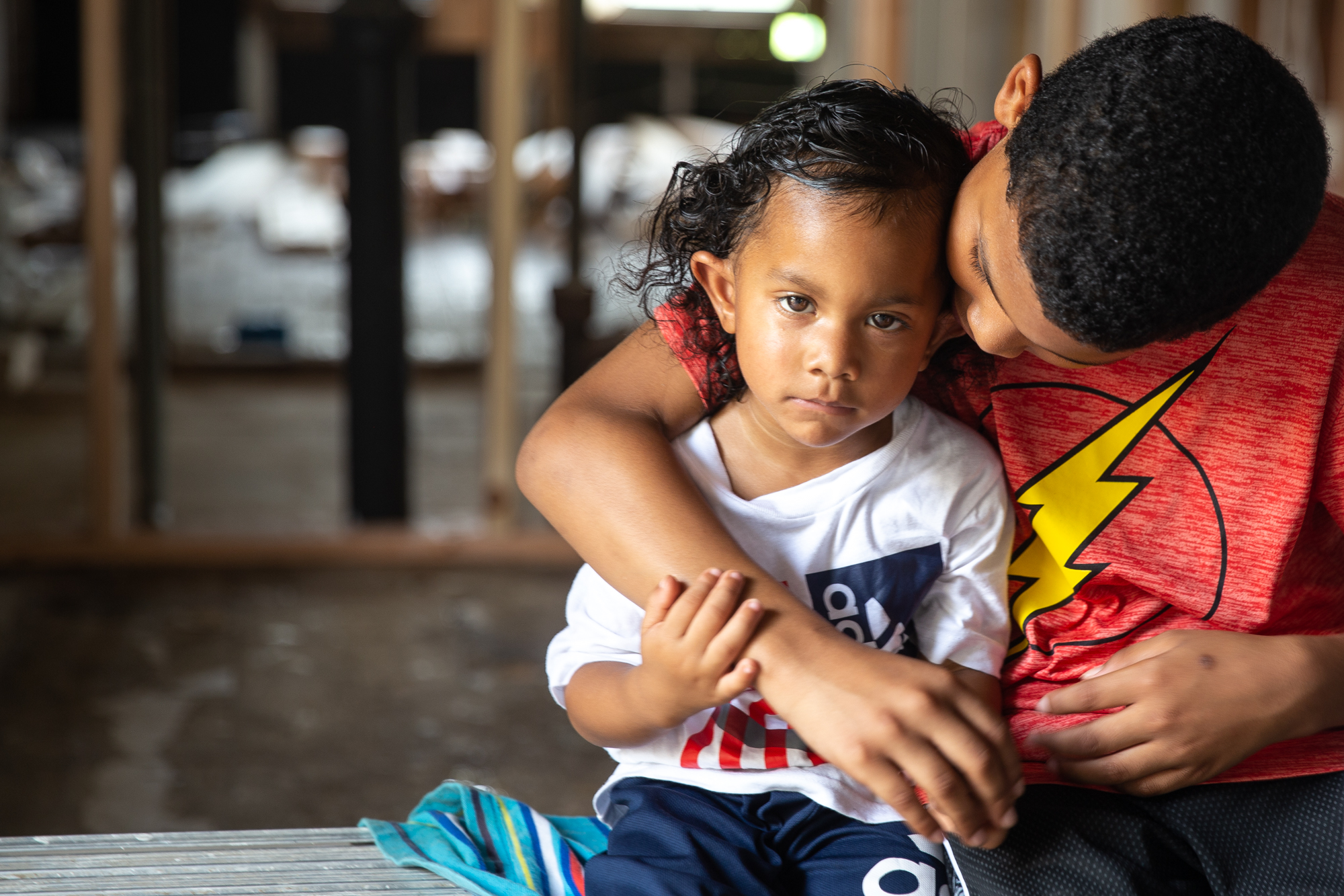 Alonzo and Walter Beal - Alonzo Beal, 11, and his 3-year-old brother, Walter, are part of a family of six living in a two-bedroom home in Houston since Hurricane Harvey destroyed their house and all their belongings. The family did not receive enough money from FEMA to repair their house, instead squeezing into the much smaller place next door. (Rachel Farrell/News21)