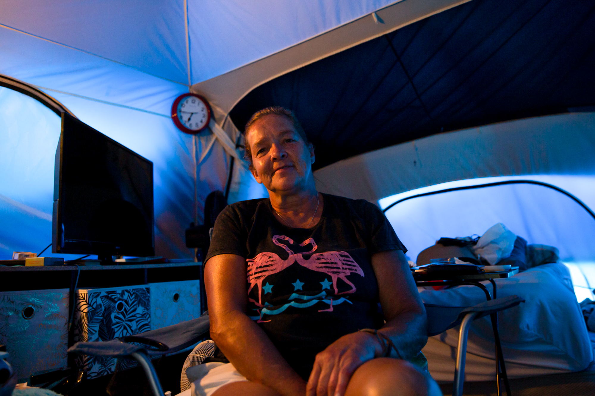 "Joyce Buschmann - Joyce Buschmann, whose home was destroyed in Hurricane Michael, now lives in a tent city in Youngstown, Florida. Buschmann's son lives 20 minutes away, but she stays in her tent so as not to burden him. ""Why leave when I'm perfectly happy here?"" she asked. (Stacy Fernández/News21)"