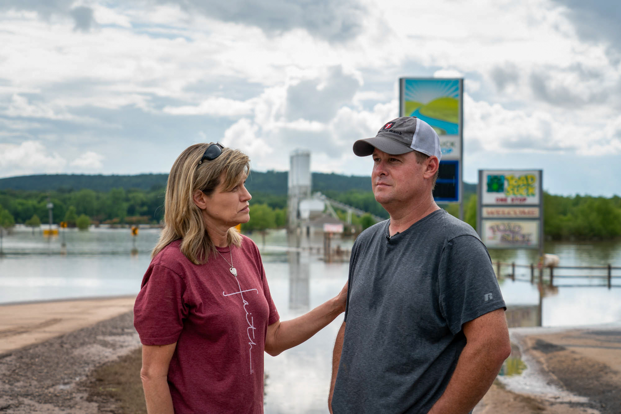 "Jason and Christy Trantina - Jason and Christy Trantina own and operate the Toad Suck One-Stop, the only store in Toad Suck, Arkansas, population 288. Jason and his employees tried to hold back the flood waters from the Arkansas River with a barrier of concrete blocks, like the Trantinas have done before. ""But this flood was different,"" Christy said. ""It was river-rushing current water, and so the current washed away some of the barrier and water got inside and it was able to get inside our store."" (Jordan Laird/News21)"