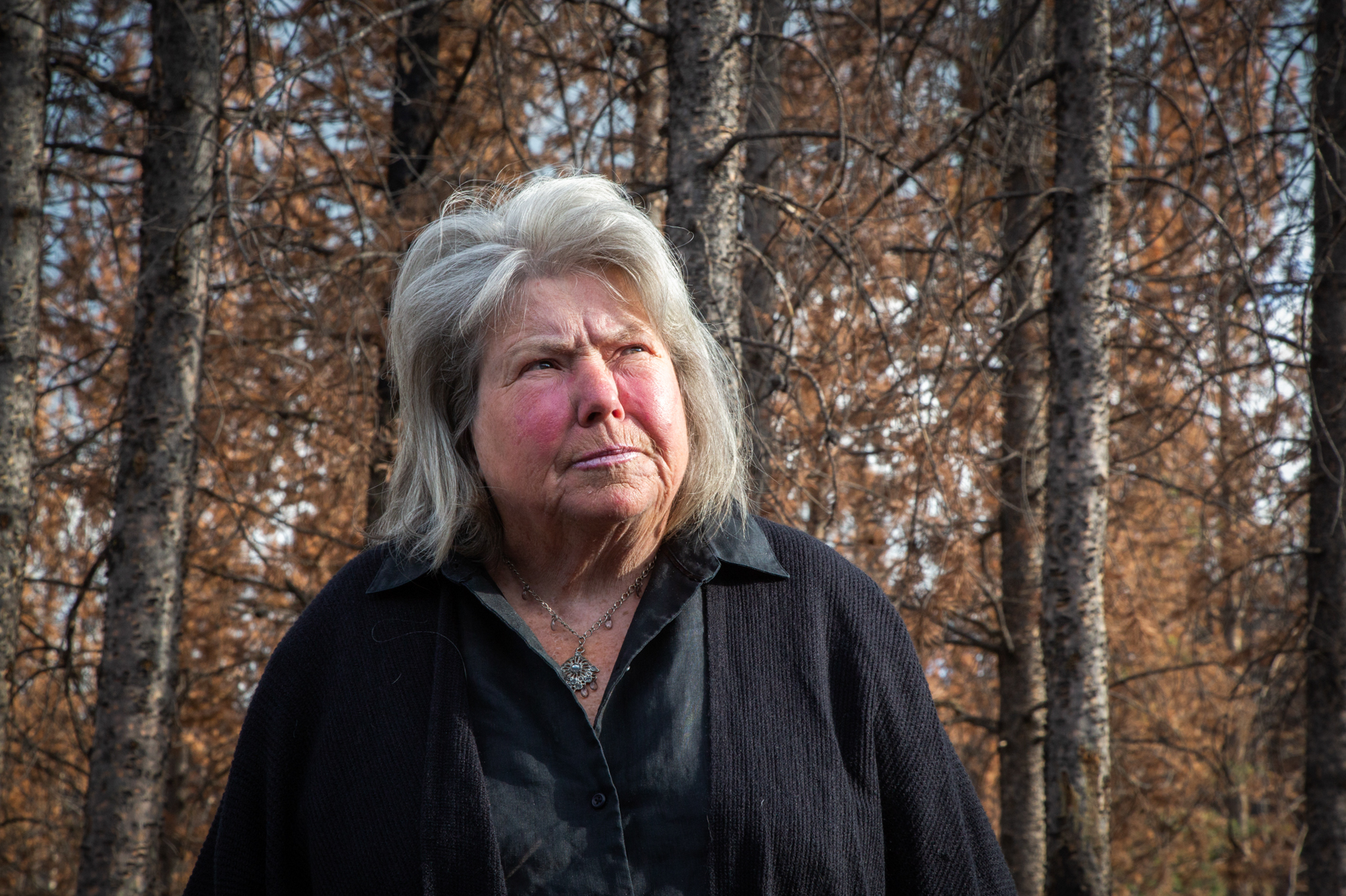 "Marlene ""Lanie"" Beebe - Marlene ""Lanie"" Beebe, who lives in Hoback Ranches, Wyoming, lost her home and a shed in the 2018 Roosevelt Fire. Beebe lived out of her truck until a neighbor bought her a trailer to place on her property. Beebe is a potter and artist, and the fire destroyed her journals and art collections. (Drew Hutchinson/News21)"