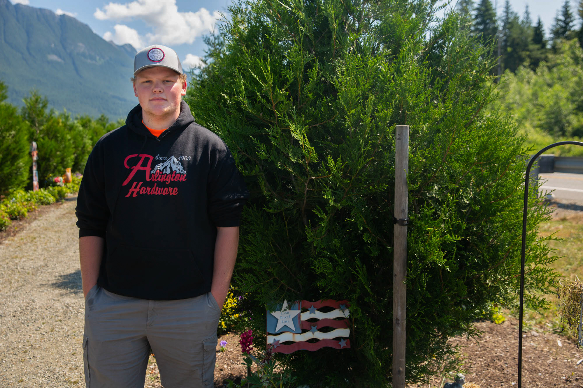 Quinton Kuntz - Quinton Kuntz stands by a tree planted in memory of his great-aunt, one of 43 residents of Oso, Washington, who died in a landslide. Kuntz was in high school at the time and missed the slide by a few hours because his baseball team had a game. (Allie Barton/News21)
