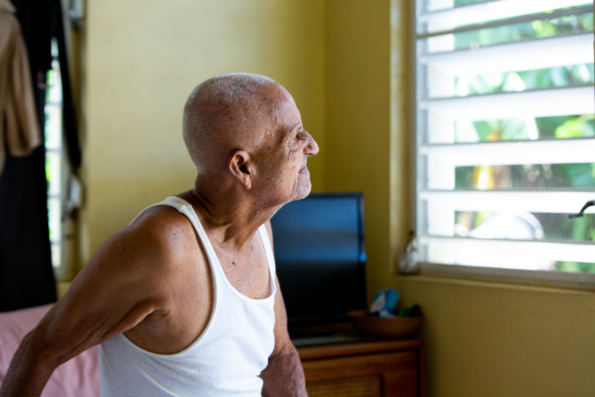 Guillermo Huertas - Guillermo Huertas, 90, has dementia and is living with his wife and daughter in Frederiksted, U.S. Virgin Islands. Although much of their house sustained heavy damage almost two years ago, the family is reluctant to move. (Anya Magnuson/News21)
