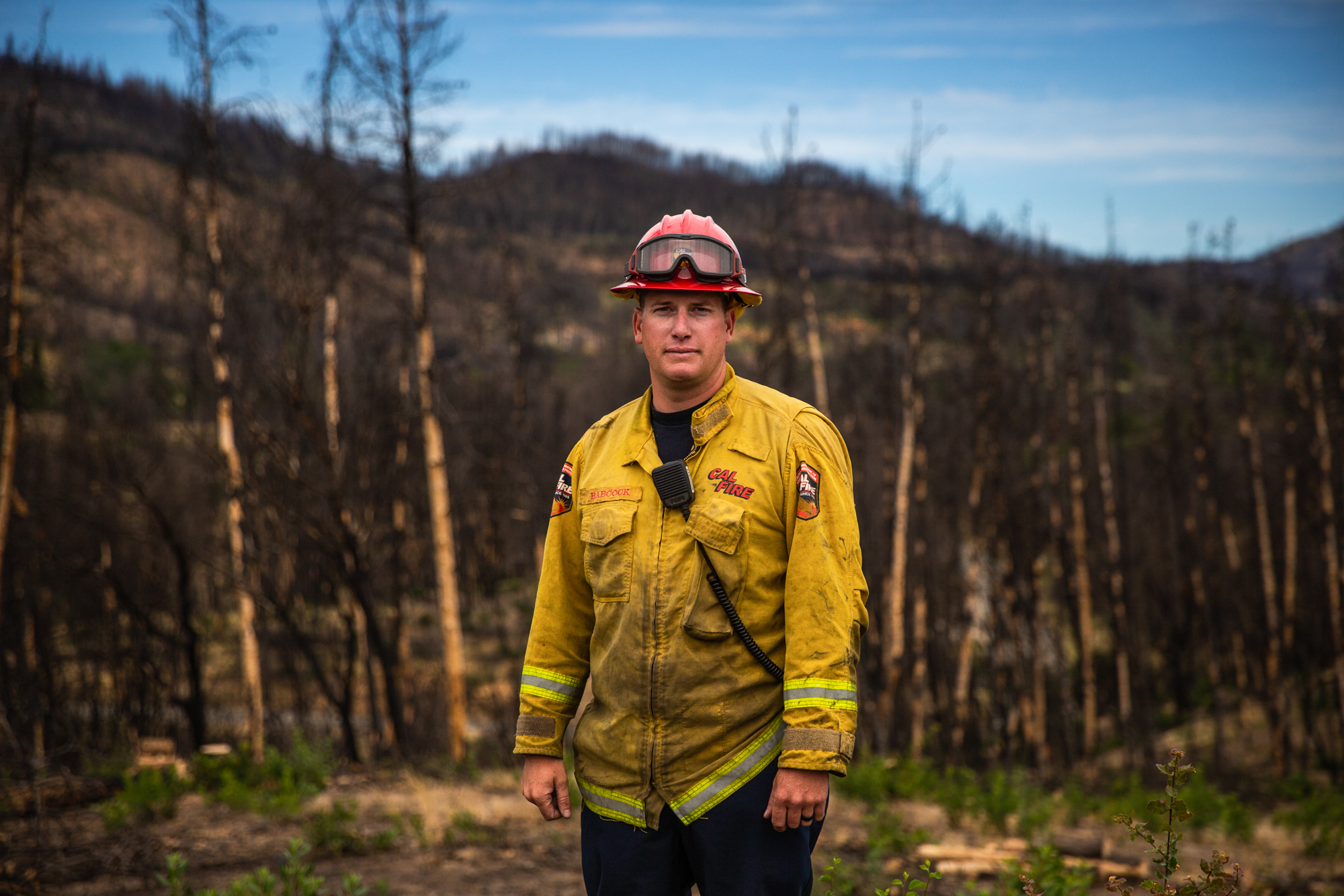 "Greg Babcock - Capt. Greg Babcock leads 26 members of Cal Fire and the California National Guard as they clear areas that burned in the 2018 Carr Fire near Redding, California, hoping to eliminate potential fuel for a future fire. ""As years progress, (fire) seasons have been getting longer,"" he said. ""It seems lately in the last few years, fires have been more devastating."" (Anton L. Delgado/News21)"