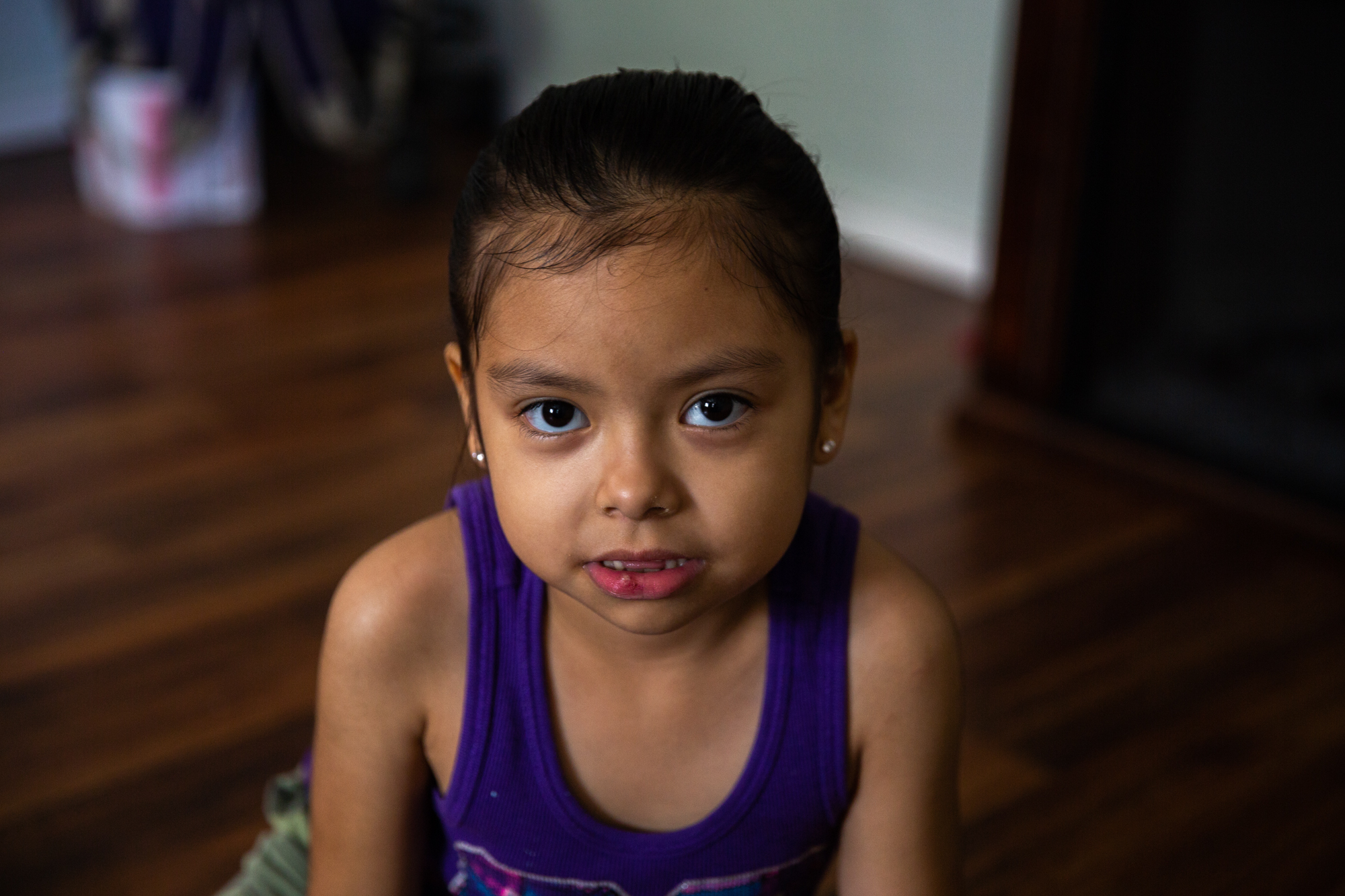 Ester Escobedo - Ester Escobedo's mother, Ruth Escobedo, worries that the poor condition of her house will negatively affect the health of her two daughters, Ester, 6, and Mia, 1. Hurricane Harvey damaged the foundation and left behind mold, cracked floorboards and uneven concrete pathways. (Rachel Farrell/News21)
