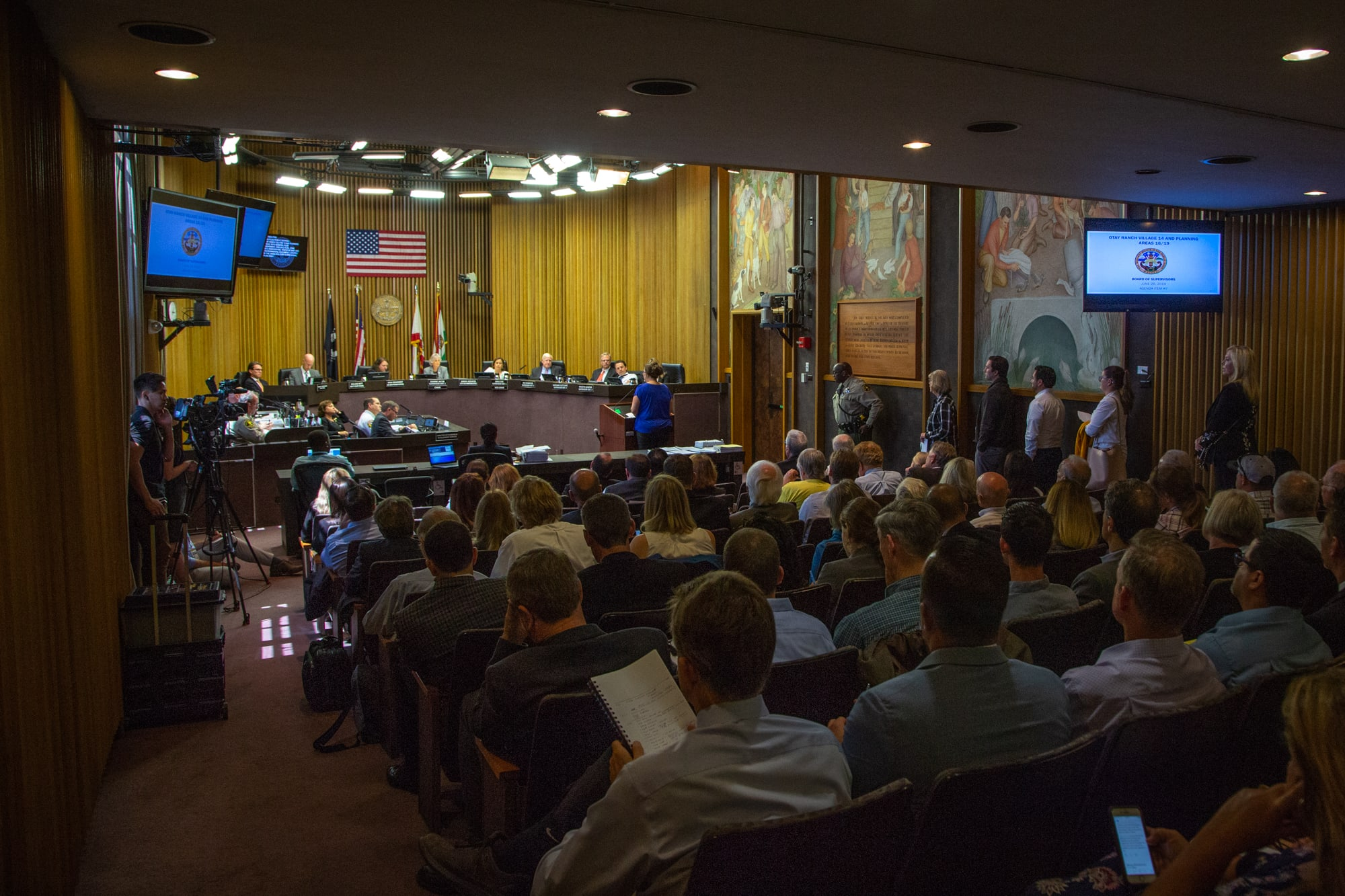San Diego County residents line up to comment on a proposed housing development in an area that has burned every seven years on average since 1950. The development was approved. (Kailey Broussard/News21)