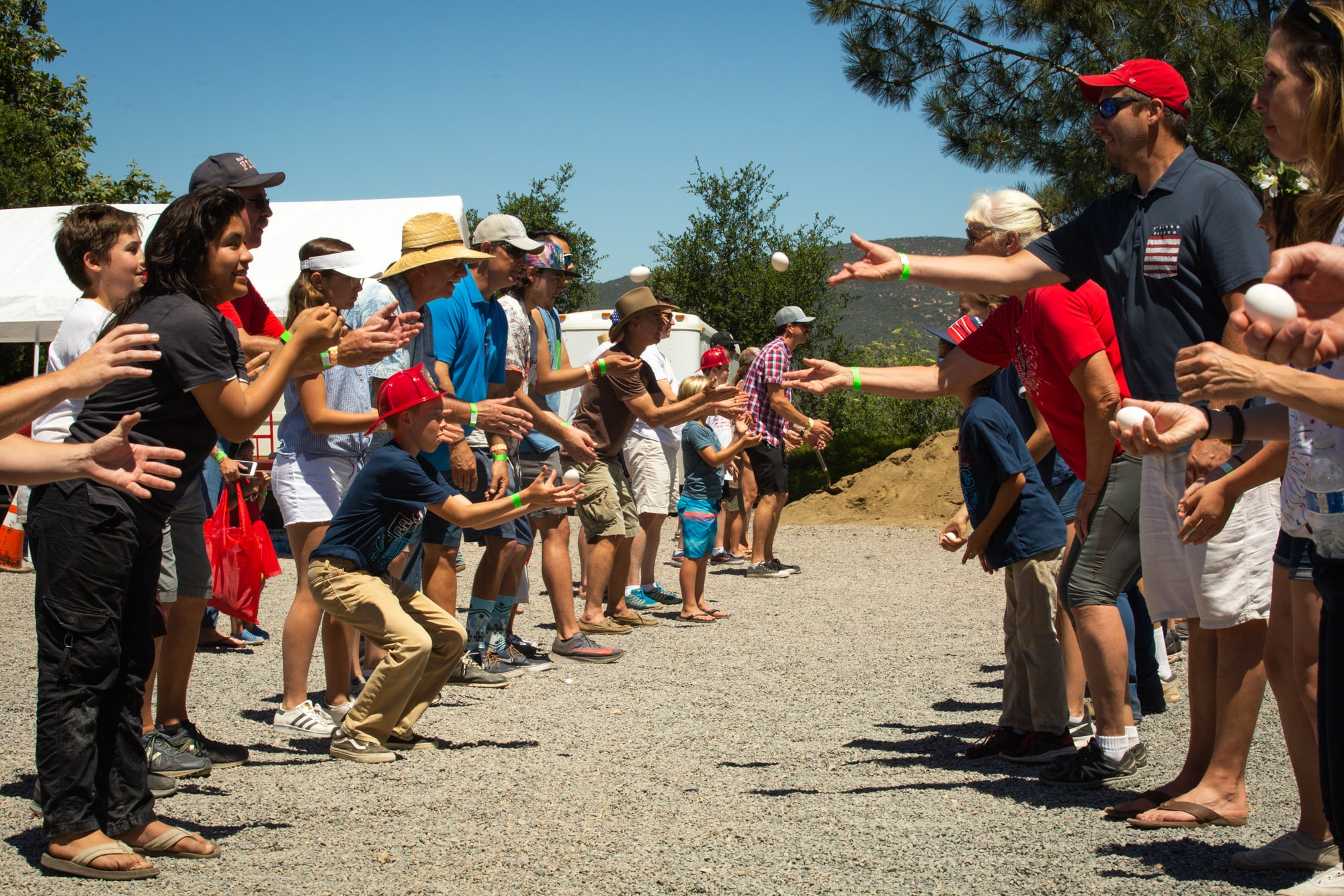 Residents of Elfin Forest and Harmony Grove, California, participate in an egg toss during the towns' 42nd annual Fourth of July parade and picnic. (Kailey Broussard/News21)