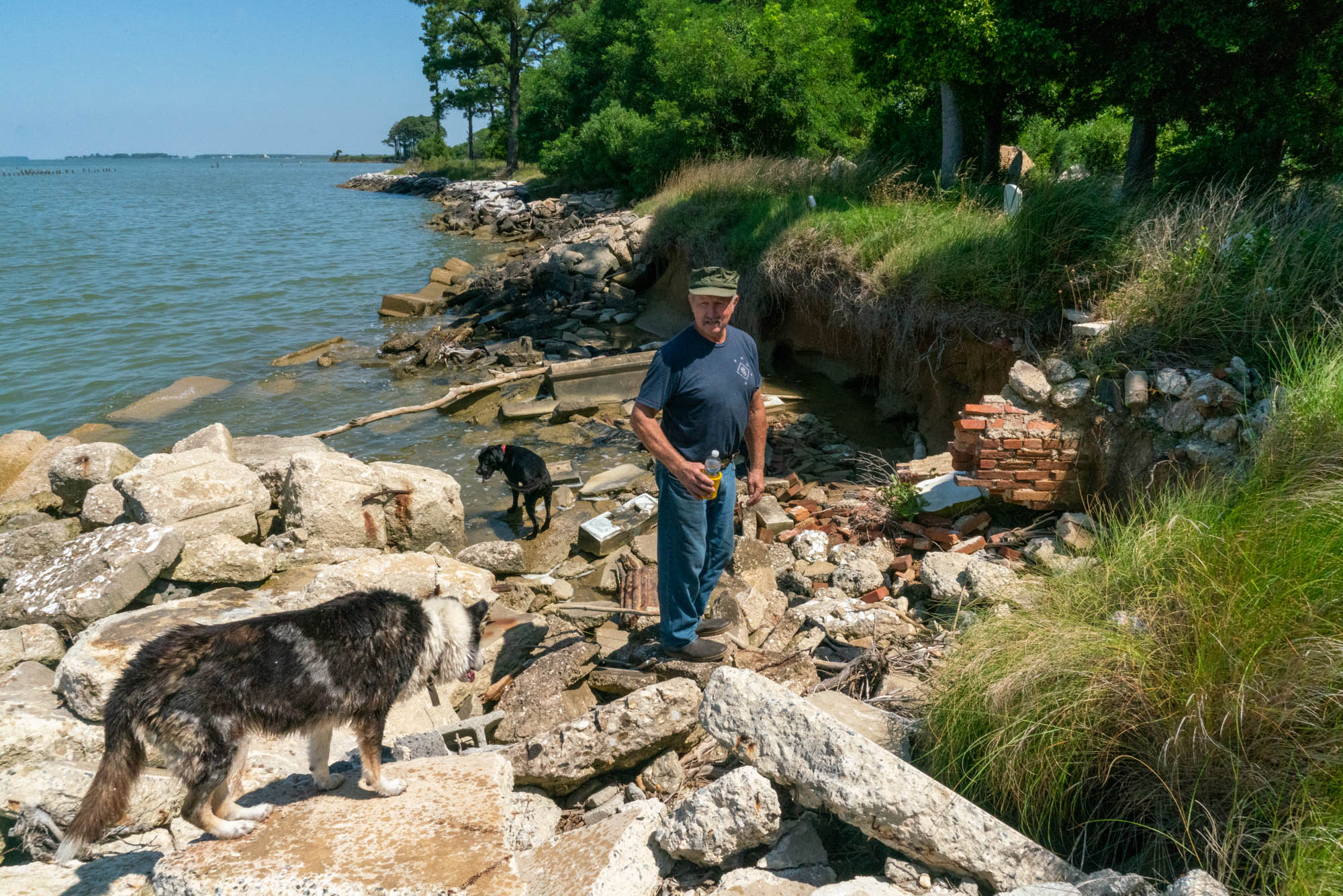 Donald Willey of Hoopers Island, Maryland, has spent 17 years trying to save the tombs and headstones of his island's ancestors from falling into the Chesapeake Bay. He has placed rocks on the shoreline to keep the water back, but it continues to seep through the barriers. (Jordan Laird/News21)