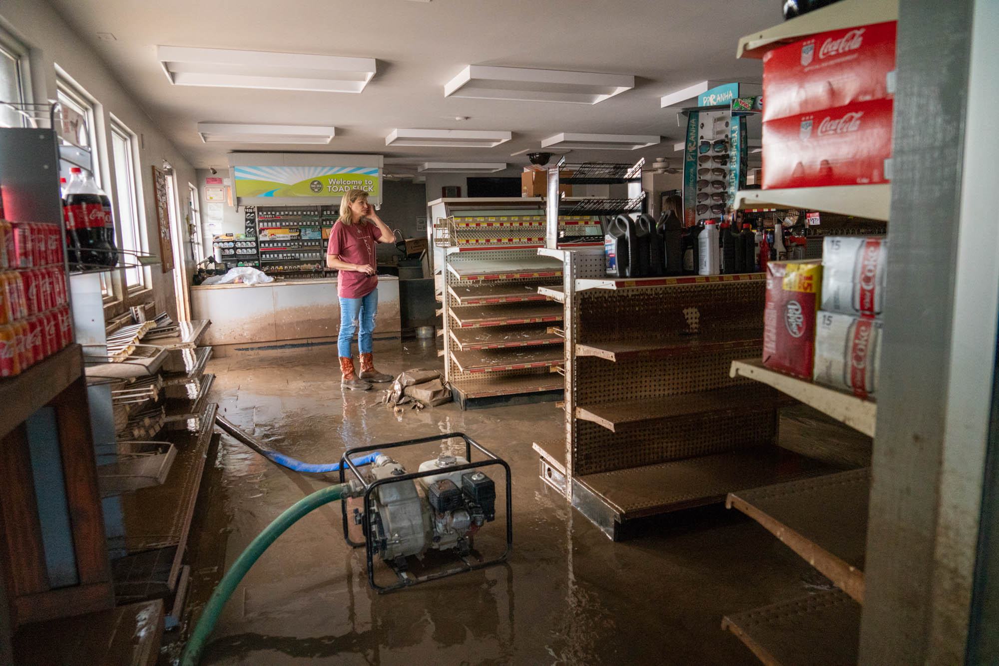 The Arkansas River overflowed its banks this year, though Jason and Christy Trantina, owners of the Toad Suck One-Stop, tried in vain to stop the deluge with concrete blocks. (Jordan Laird/News21)